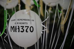 Balloons with the name of the missing Malaysia Airlines flight MH370 are seen displayed during a memorial event in Kuala Lumpur on Sunday, March 6, 2016.