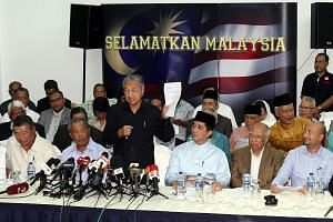 Tan Sri Muhyiddin Yassin (front row, second from left) and Datuk Seri Mukhriz Mahathir (front row, far right) at the