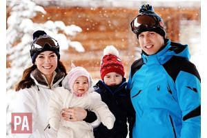 Prince William, his wife Kate and their children on holiday.