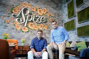 Brothers Anil (left) and Haresh Sabnani have taken their Spize brand from coffee shop to restaurant chain.