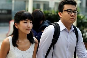 Ai Takagi (left) and Yang Kai Heng arriving at the State Courts for a pre-trial conference on May 18, 2015.
