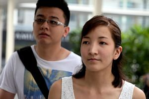 Ai Takagi (right, seen with husband Yang Kaiheng), was found to have posted numerous articles on defunct website The Real Singapore under the fictitious name of 'Farhan'.