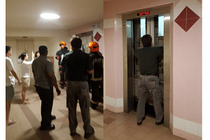 Members of the SCDF at the scene, where Ms Evi Lisnawati was freed with the help of a lift technician (right).