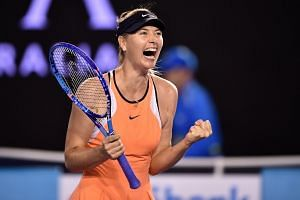 Maria Sharapova celebrates after winning her women's singles match against Switzerland's Belinda Bencic during the 2016 Australian Open tennis tournament.