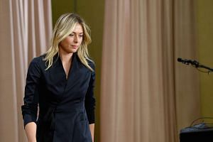 Maria Sharapova prepares to address the media regarding a failed drug test at The LA Hotel Downtown on March 7, 2016.
