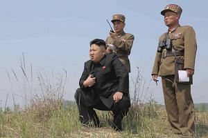 North Korean leader Kim Jong Un (centre) guiding the multiple-rocket launching drill of women's sub-units under KPA Unit 851, in this undated file photo released by North Korea's Korean Central News Agency on April 24, 2014.