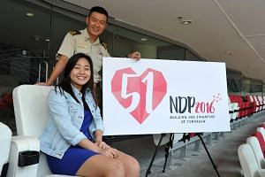 NDP2016 Logo Designer, Lim Xin Chelsea, 19, and Chairman of the NDP2016 Executive Committee, Brigadier-General Kenneth Liow, 46, with the NDP 2016 logo.
