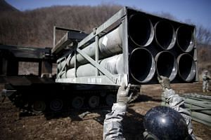 A US soldier loads rocket pods as they prepare for a live-fire training exercise near Cheorwon on March 9, 2016.