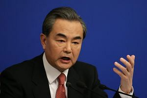 Chinese Foreign Minister Wang Yi gesturing during a press conference of the fourth session of the 12th National People's Congress in Beijing, China, on March 8, 2016.