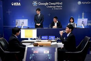 South Korean Lee Se Dol (right), the world's top Go player, has been beaten by Google's AlphaGo for the second time.