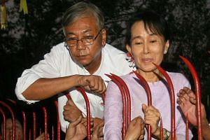 Mr Htin Kyaw (left) has been nominated by Aung San Suu Kyi's party to be Myanmar's next president.