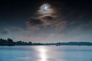 ST reader Cedric Ng sent in this shot of the eclipse taken over Lower Seletar Reservoir.