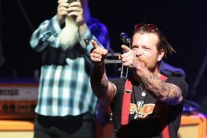 Jesse Hughes (right), the singer of US rock group Eagles of Death Metal, gestures during their concert at the Olympia concert hall in Paris, on Feb 16, 2016.