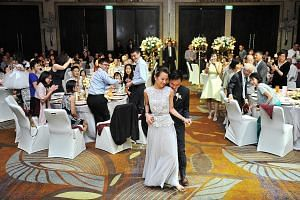 Mr Lee Qianwen, and Ms Stacey Su having their first dance during their wedding party at W Singapore Sentosa Cove on March 5. After paying for a menu upgrade, they spent more than $200 on each of their 340 guests.