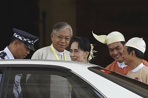 Myanmar's newly elected president Htin Kyaw (second left) and NLD party leader Aung San Suu Kyi (centre) leaving the parliament at Naypyidaw, Myanmar, on March 15, 2016.