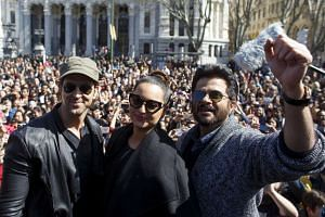 From left: Indian actors Hrithik Roshan, Sonakshi Sinha and Anil Kapoor pose as they take part in a flashmob in Madrid, on March 13, 2016.