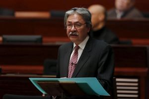Hong Kong Financial Secretary John Tsang addresses the annual budget report at the Legislative Council in Hong Kong, on Feb 24, 2016.