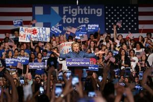 Democratic presidential candidate Hillary Clinton speaks to her supporters during her Primary Night Event at the Palm Beach County Convention Center in Florida on March 15, 2016.