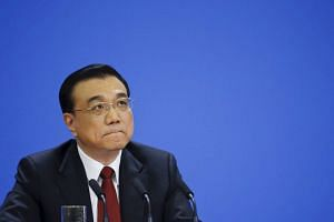 China's Premier Li Keqiang attending a news conference following the closing ceremony of China's National People's Congress at the Great Hall of the People on March 16, 2016.