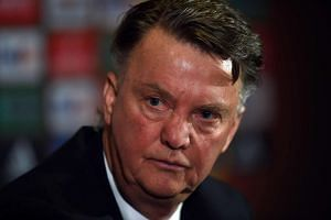 Van Gaal hosts a press conference at Old Trafford in Manchester on March 16, 2016.