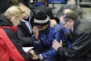 A psychologist speaking with a relative of a victim of the crashed Flydubai plane at the Rostov-on-Don airport.