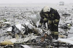 Members of the Emergencies Ministry searching the wreckage at the crash site.
