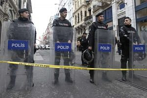 Turkish policemen cordoning off Istiklal Street in Istanbul after the attack.