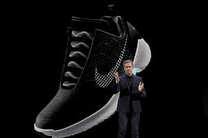 The Nike HyperAdapt 1.0 self-lacing shoe is displayed as Nike CEO Mark Parker speaks during a launch event in New York.