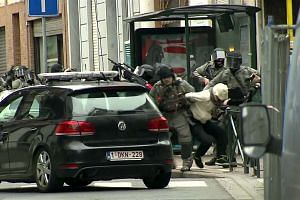 Armed Belgian police apprehend a suspect on March 18, 2016, thought to be Abdeslam.