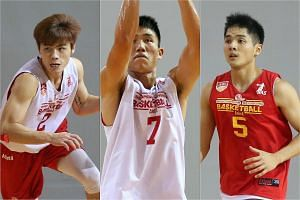 Singapore Slingers players Desmond Oh (left), Wu Qingde (centre) and Wong Wei Long.