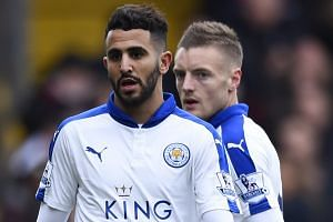 Leicester City's Riyad Mahrez (left) and Jamie Vardy.