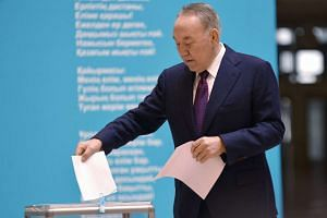 Kazakh President Nursultan Nazarbayev casting his vote at a polling station in Astana, Kazakhstan, on March 20, 2016.