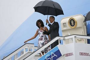 US President Barack Obama and his wife Michelle exit Air Force One as they arrive at Havana's international airport for a three-day trip, in Havana on March 20, 2016.