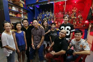 (From left) Ms Louisa Wi, 44, Lia Tan, 12, temple founder Joel Tan, 45, Mr Eddie Png, 47, Ms Jamie Ang, 35, Josiah Tan, 14, Mr Edmund Koh (seated), 27, Mr Kelvin Soon, 35, and Mr Jeffrey Ong, 54, are committee members at Yun Yin Dian temple, where yo