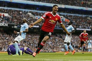 Marcus Rashford celebrates after scoring for Manchester United in its 1-0 over Manchester City on Sunday.