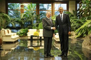 US President Barack Obama and Cuba's President Raul Castro shake hands in Havana on Monday (March 21).