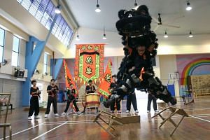 Alfred Lee, 11, practising stunts as the lion head. Telok Kurau Primary has been crowned champion of the primary school category for seven straight years from 2009.