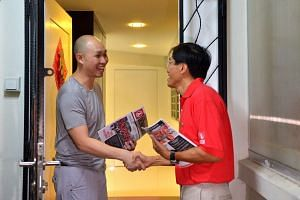 SDP chief Chee Soon Juan greeting a resident during house visits around Bukit Batok, on March 22, 2016.