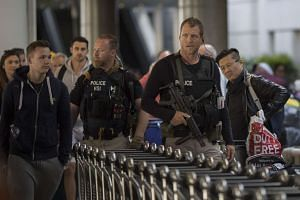 US Homeland Security Investigations police patrolling Los Angeles International Airport after the bomb attacks in Brussels, on March 22.