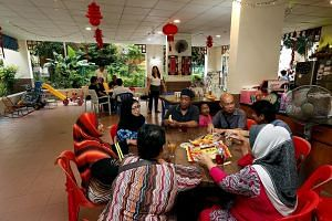 Many residents, young and old, have made an informal second home of the void deck of Block 603, Yishun Street 61, where they gather regularly to chat and eat.
