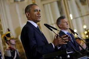 US President Barack Obama and Argentina's President Mauricio Macri attend a news conference at the Casa Rosada government house.