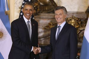 Argentina's President Mauricio Macri (right) greets US President Barack Obama at the Casa Rosada government house.