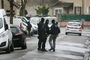 Police officers outside a building where an anti-terrorism operation took place in Argenteuil, near Paris.