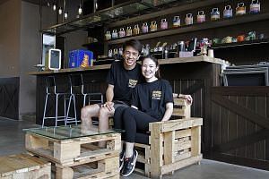 Mr Chiang and Ms Png at one of their pop-up eateries, Paella Place, in Somerset. A pop-up store costs them less than $20,000.