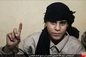 A photo of the alleged bomber was posted online by ISIS.