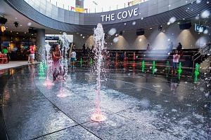 At basement two of this mall (above), which opened in January, is a hybrid amphitheatre and water-play area called The Cove.