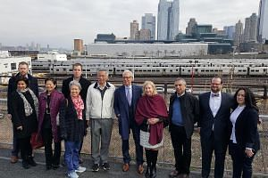 PM Lee and Mrs Lee at the High Line yesterday. Also present is Emeritus Chair John Alschuler (fifth from right) of Friends of the High Line's board. Friends of the High Line is a non-profit body that operates the park.