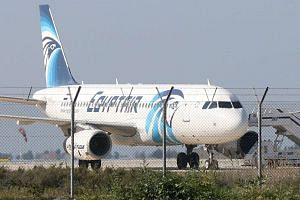 An EgyptAir Airbus A320 sits on the tarmac of Larnaca aiport after it was hijacked and diverted to Cyprus on March 29, 2016.