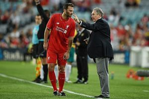 Gerard Houllier at his last public outing, with former Liverpool player Patrik Berger during Liverpool Legends' exhibition game against Australian Legends in January in Sydney. The Frenchman is performing his ambassador role at Tampines for free.
