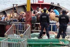 The Chinese fishing boat and its crew being detained on March 22 for illegally harvesting coral and endangered turtles in waters near a disputed atoll in the South China Sea.